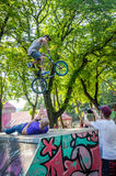 Lviv, Ukraine - July 2015: Yarych street Fest 2015. Extreme jumping on a BMX bike and perform stunts in the air Stock Images