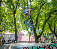 Lviv, Ukraine - July 2015: Yarych street Fest 2015. Extreme jumping on a BMX bike and perform stunts in the air Royalty Free Stock Photography
