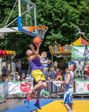 Lviv, Ukraine - July 2015: Yarych street Fest 2015. Street basketball competition at the festival near Lviv Opera House. Players f Royalty Free Stock Image