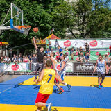 Lviv, Ukraine - July 2015: Yarych street Fest 2015. Street basketball competition at the festival near Lviv Opera House. Players f Royalty Free Stock Photography