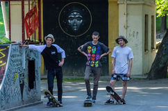 Lviv, Ukraine - July 2015: Yarych street Fest 2015. Three extreme skateboarders preparing for the performance at the festival and Royalty Free Stock Images