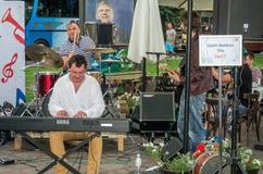 Lviv, Ukraine - June 2015: Alfa Jazz Fest 2015. Speech jazz group Usein Berikov Trio in competition at the festival on the street. Lviv, Ukraine - June 2015 Royalty Free Stock Photos