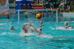 LVIV, UKRAINE - JUNE, 2019: Athletes in the pool playing water polo. Athletes in the pool playing water polo royalty free stock photos