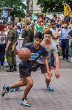 LVIV, UKRAINE - JUNE 2016: Basketball players are playing on the square in the street basketball, streetball jumping fighting for Royalty Free Stock Photos