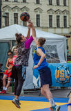 LVIV, UKRAINE - JUNE 2016: Basketball players are playing on the square in the street basketball, streetball jumping fighting for Stock Images