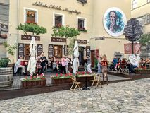 Paired dances in a street cafe. LVIV, UKRAINE - JUNE 29: Men and women dancing in pairs in a street cafe in Lviv on June 29, 2017 in Lvov, Ukraine Stock Images