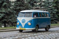 LVIV, UKRAINE - JUNE 2018: Old vintage retro classic blue and white Volkswagen camper bus car rides through the streets of the cit. Old vintage retro classic stock photo