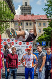 LVIV, UKRAINE - JUNE 2016: Young boy athlete demonstrates his ability by performing different exercises and figures on the horizon Royalty Free Stock Photography