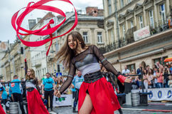LVIV, UKRAINE - JUNE 2016: Young charming sexy girls perform a dance with her on the street in front of the audience in the red, w Royalty Free Stock Photo