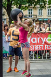 LVIV, UKRAINE - JUNE 2016: Young pretty sexy girl with a sports figure lifts a heavy ball Stock Images