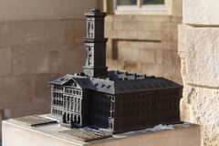 LVIV, UKRAINE - March 1, 2018. Bronze mini-layout of the Town Hall of Lviv. royalty free stock images