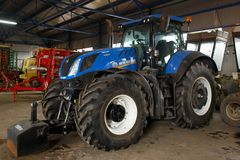 LVIV UKRAINE MARCH 16 2018: Tractor New Holland T7 Series T7.315. Space for text. New Holland Machine Company was founded in 1895. Absoletely new Tractor New stock photo