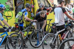 LVIV, UKRAINE - MAY 2018: The cyclist repairs his bicycle by pumping a punctured wheel. The cyclist repairs his bicycle by pumping a punctured wheel stock images