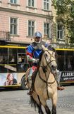 LVIV, UKRAINE - MAY 2018: Knight sitting on a horse in a carnival costume rides in the center of the city on parade royalty free stock photos