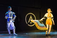 Man and woman performs on stage at the cosplay festival royalty free stock images