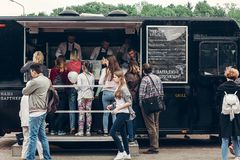 Lviv, Ukraine - May 21, 2017: Mobile drink and snack and refresh. Ments van at street food festival. food truck with bbq at eating market Stock Image