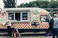 Lviv, Ukraine - May 21, 2017: Mobile drink and snack and refresh. Ments van at street food festival. food truck with bbq at eating market Royalty Free Stock Photography