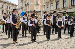 LVIV, UKRAINE - MAY 2018: The musical orchestra performs at an exhibition concert during a parade in the center of the city. The musical orchestra performs at an Stock Image
