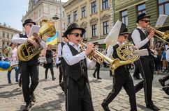 LVIV, UKRAINE - MAY 2018: The musical orchestra performs at an exhibition concert during a parade in the center of the city. The musical orchestra performs at an Stock Photos