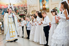 LVIV, UKRAINE - MAY 8, 2016: Priest at ceremony of a First Commu Royalty Free Stock Images