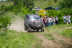LVIV, UKRAINE - MAY 2016: Sport rally car racing on a dirt road dust raising clubs at the training base in the field Royalty Free Stock Images