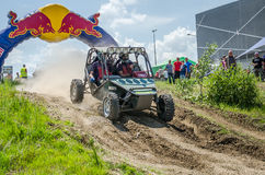 LVIV, UKRAINE - MAY 2016: Sport rally car racing on a dirt road dust raising clubs at the training base in the field Royalty Free Stock Photo