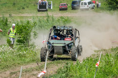 LVIV, UKRAINE - MAY 2016: Sport rally car racing on a dirt road dust raising clubs at the training base in the field Stock Photo