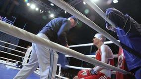 LVIV, UKRAINE - November 14, 2017 Boxing tournament. Coach instructs boxer between rounds. LVIV, UKRAINE - November 14, 2017 Boxing tournament. Coach instructs stock video