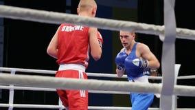 LVIV, UKRAINE - November 14, 2017 Boxing tournament. Lightweight boxer sends opponent to knockdown. LVIV, UKRAINE - November 14, 2017 Boxing tournament stock video footage