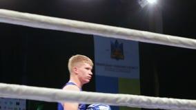 LVIV, UKRAINE - November 14, 2017 Boxing tournament. Midweight boxers fight in boxing ring. LVIV, UKRAINE - November 14, 2017 Boxing tournament. Midweight stock video footage