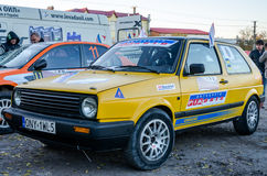 Lviv, Ukraine - Otober 2015: A racing car for the rally in a closed garage before the start of the race which sets up a mechanic a. Lviv, Ukraine - Otober 2015 royalty free stock photos