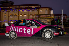 Lviv, Ukraine - Otober 2015: Racing rally car driving on the asphalt road on the night stage, which is controlled by the driver of. Lviv, Ukraine - Otober 2015 Royalty Free Stock Image
