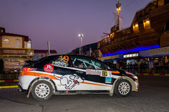 Lviv, Ukraine - Otober 2015: Racing rally car driving on the asphalt road on the night stage, which is controlled by the driver of. Lviv, Ukraine - Otober 2015 Royalty Free Stock Images