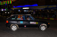 Lviv, Ukraine - Otober 2015: Racing rally car driving on the asphalt road on the night stage, which is controlled by the driver of. Lviv, Ukraine - Otober 2015 Stock Photos