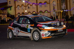 Lviv, Ukraine - Otober 2015: Racing rally car driving on the asphalt road on the night stage, which is controlled by the driver of. Lviv, Ukraine - Otober 2015 Stock Image
