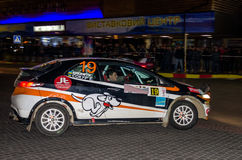 Lviv, Ukraine - Otober 2015: Racing rally car driving on the asphalt road on the night stage, which is controlled by the driver of Royalty Free Stock Images