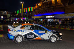 Lviv, Ukraine - Otober 2015: Racing rally car driving on the asphalt road on the night stage, which is controlled by the driver of Royalty Free Stock Photos