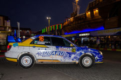 Lviv, Ukraine - Otober 2015: Racing rally car driving on the asphalt road on the night stage, which is controlled by the driver of Stock Image
