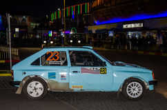 Lviv, Ukraine - Otober 2015: Racing rally car driving on the asphalt road on the night stage, which is controlled by the driver of Stock Photography
