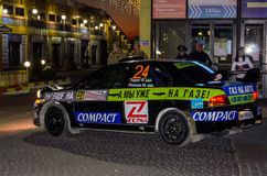 Lviv, Ukraine - Otober 2015: Racing rally car driving on the asphalt road on the night stage, which is controlled by the driver of. Lviv, Ukraine - Otober 2015 Royalty Free Stock Photos