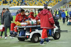 LVIV, UKRAINE - SEP 29: The ambulance takes away football playe stock photography