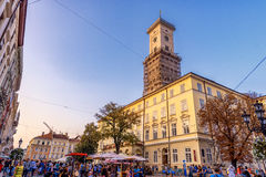 LVIV, UKRAINE - SEPTEMBER 12, 2016: Lviv City and Lviv Old Town With People. Sunset Light and Lviv City Hall Royalty Free Stock Image