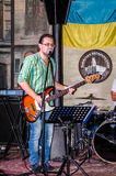 Lviv, Ukraine - September 2015: The musician plays guitar and sings in the Lviv Café before the audience fans Stock Photography