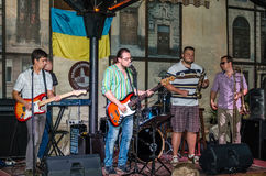 Lviv, Ukraine - September 2015: Musicians play the trumpet, guitar, piano and drums at the Lviv Café before the audience fans Royalty Free Stock Image