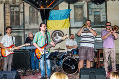 Lviv, Ukraine - September 2015: Musicians play the trumpet, guitar, piano and drums at the Lviv Café before the audience fans Stock Photography