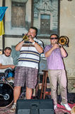 Lviv, Ukraine - September 2015: Musicians playing trumpet in Lviv cafes before the audience fans Stock Photo