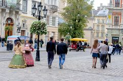 Lviv, Ukraine - september 22, 2012: The Old Town of Lviv. Square market. Girls on the street serve candy royalty free stock photos