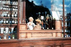 Showcase of a vintage pharmacy with potions, flasks, bottles and a puppet pharmacist, located in the city of Lviv royalty free stock photos