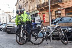 Lviv, Ukraine 06.11.2018. Two police officers in bicycle helmets. Police patrol by bicycles. royalty free stock images