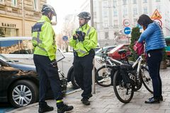 Lviv, Ukraine 06.11.2018. Two police officers in bicycle helmets. Police patrol by bicycles. Police issue fines stock image